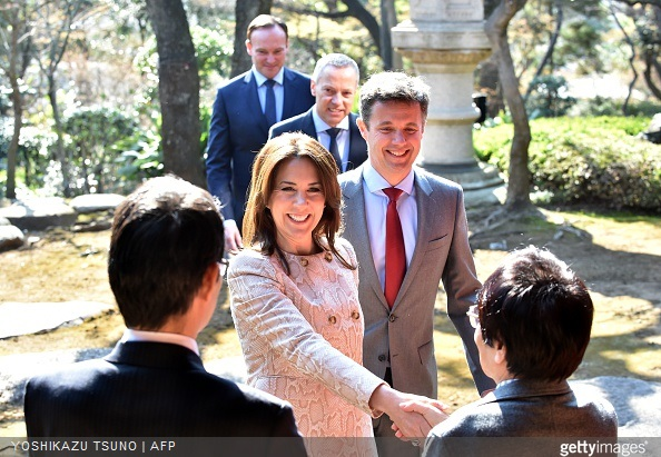 Danish Crown princess Mary and Crown Prince Frederik greet Naoki Ogi professor of pedagogy of Hosei University as they arrive at a traditional Japanese garden to meet young Japanese students and education workers in Tokyo