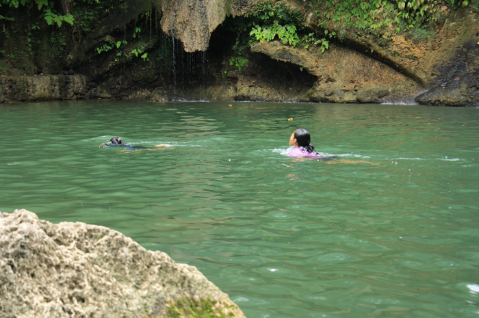 Locals enjoying the cool water of Gunhuban