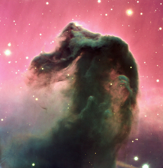 The Horsehead Nebula  A reproduction of a composite colour image of the Horsehead Nebula and its immediate surroundings. It is based on three exposures in the visual part of the spectrum with the FORS2 multi-mode instrument at the 8.2-m KUEYEN telescope at Paranal. It was produced from three images, obtained on February 1, 2000, with the FORS2 multi-mode instrument at the 8.2-m KUEYEN Unit Telescope and extracted from the VLT Science Archive Facility . The frames were obtained in the B-band (600 sec exposure; wavelength 429 nm; FWHM 88 nm; here rendered as blue), V-band (300 sec; 554 nm; 112 nm; green) and R-band (120 sec; 655 nm; 165 nm; red). The original pixel size is 0.2 arcsec. The photo shows the full field recorded in all three colours, approximately 6.5 x 6.7 arcmin 2 . The seeing was about 0.75 arcsec.  Image Credit: ESO Explanation from: http://www.eso.org/public/images/eso0202a/