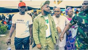 Davido recording with his NYSC uniform