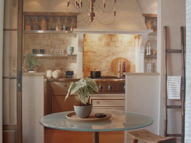 Elegant European farmhouse style kitchen Solis Betancourt stone walls open shelving glass table