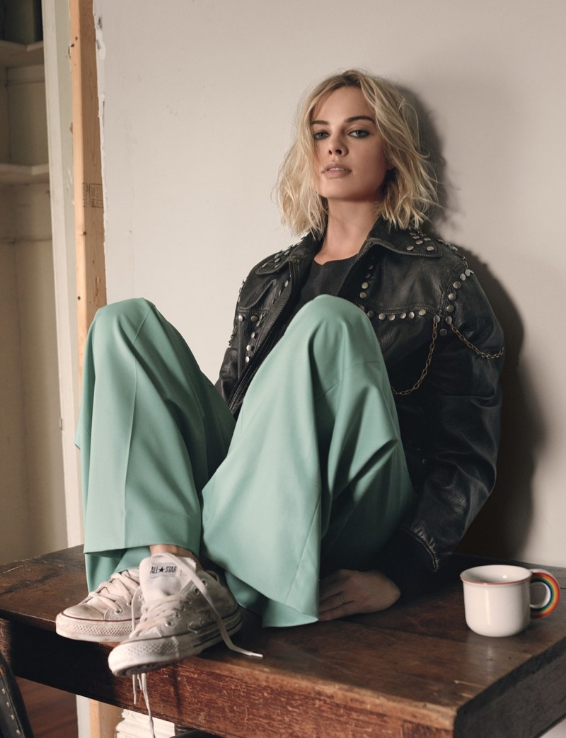 Margot Robbie poses in Gucci leather jacket, Zadig & Voltaire shirt, Chloe pants and Converse sneakers