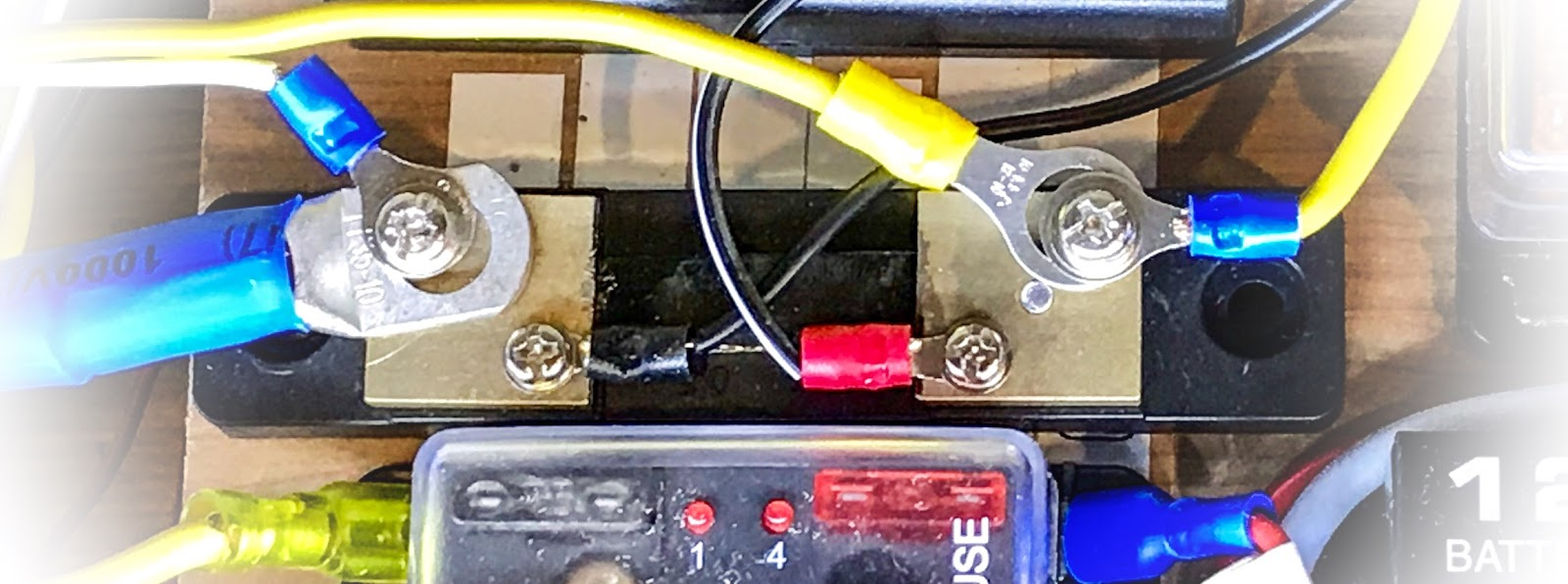 small resolution of the two terminals at the middle of the shunt is what you connect to the volt amp meter it s not difficult to wire this at all yourself