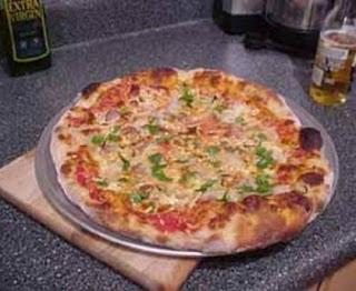 Pizza regina (ham, mushrooms, cheese)