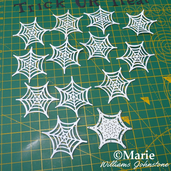 Die cutting Sizzix spider webs from white silver card paper for mini garland banner bunting