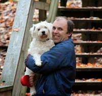 Me holding Suki in the forest in Michigan among the fall color.