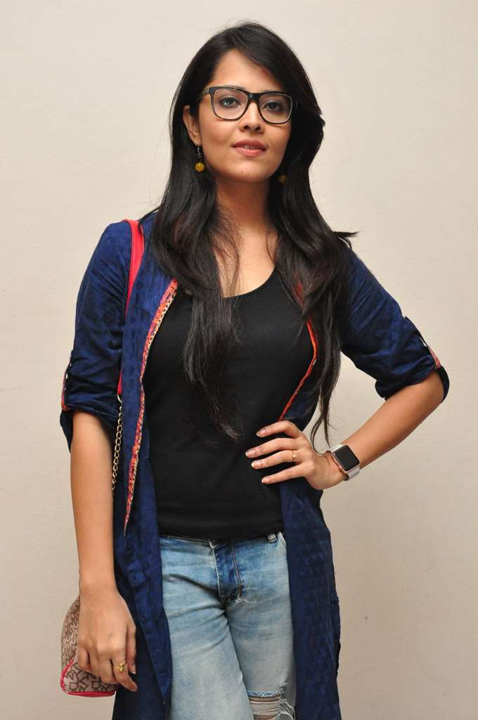 South Indian Tv Anchor Anasuya Hot Photos In Blue Top Jeans With Glass