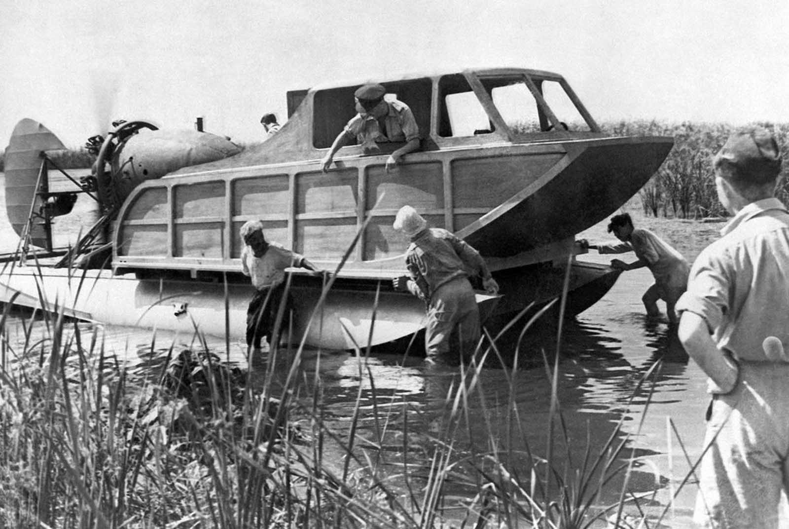 This hydroplane is part of the R.A.F. rescue service in the Middle East. It operates on the lakes of the Nile Delta for the assistance of pilots who may make forced landings in the water. Consisting of a cabin mounted on seaplane flats it is driven by an aircraft engine and propeller mounted in the stern and steered by an aircraft rudder. There are also rudders on each of the floats. The top speed of the craft is about fifteen knots. Photo taken on March 11, 1942.