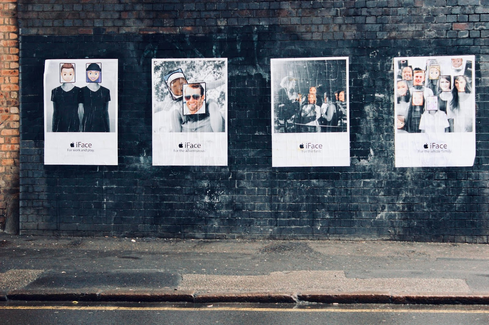 Four 'iFace' advertisements on a brick wall