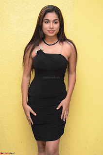 Vrushali Gosavi in strapless Short Black Dress At Follow Follow U Audio Launch 066.JPG