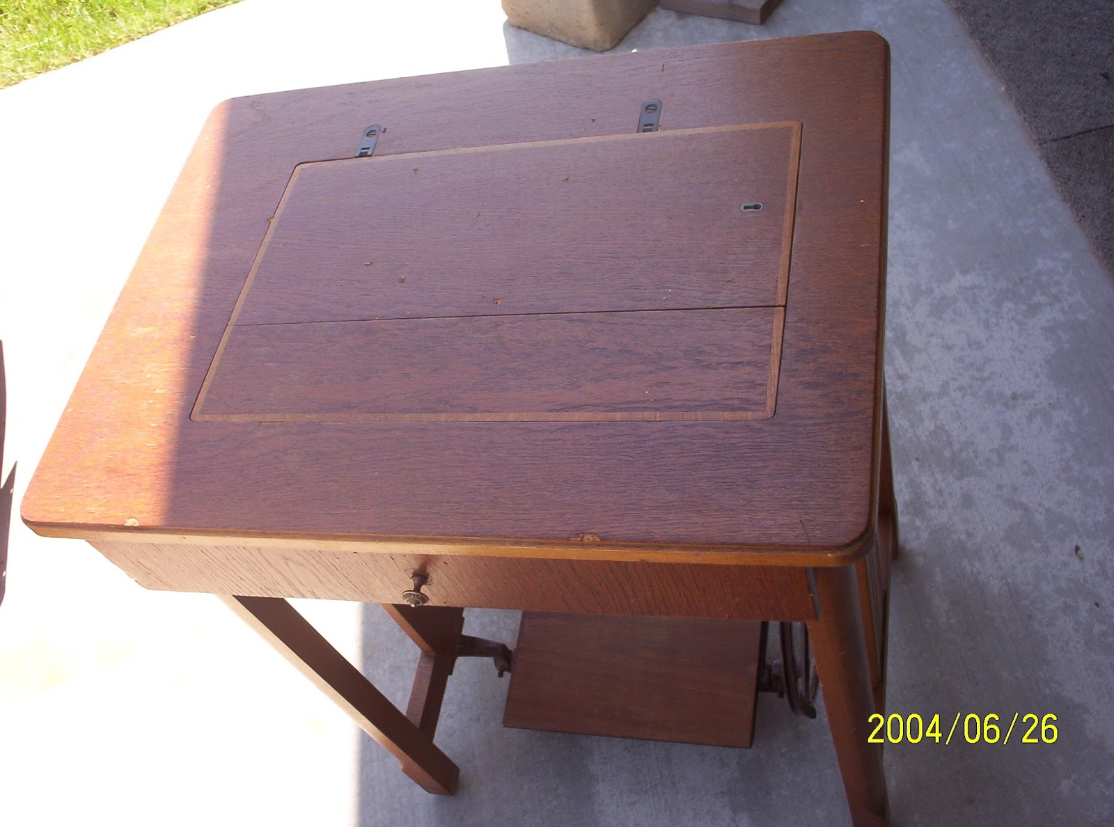 Torpedo Treadle Sewing Machine Table, In Closed Position, With Sewing  Machine Neatly Locked Under The Center Wood Insert. There Is A Very Short  Depth Drawer ...