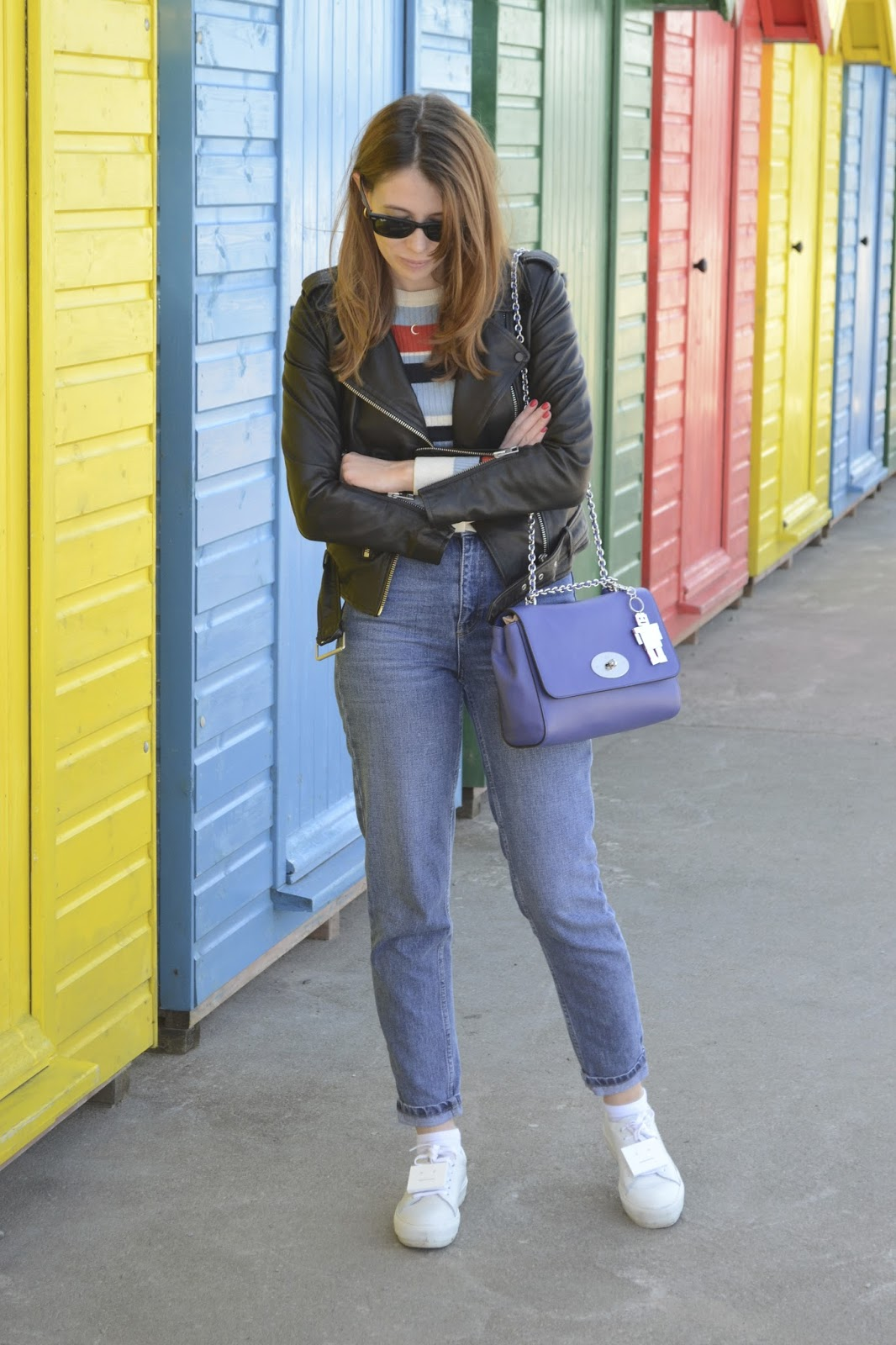 Affordable women's fashion blog ft Black leather jacket from Allsaints, Denim Mom style jeans from Topshop, Striped jumper from Urban outfitters, Blue Mulberry lily bag, Acne trainers.