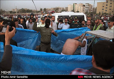 Flogging of a convict prior to his public execution in Karaj, Iran, in Aug. 2015