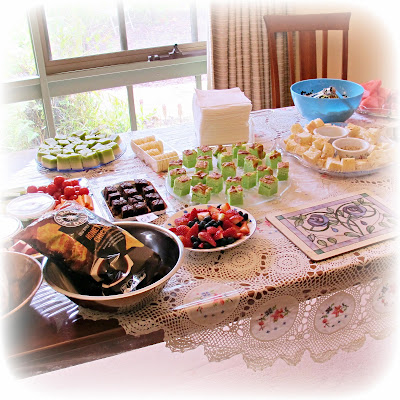 birthday party food spread table cake fruit chips dukkah crudites dips