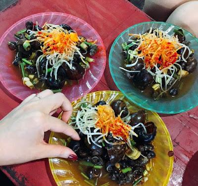 Sucking snails (Oc Hut) - famous street food in  Da Nang