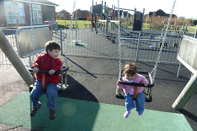 Two children on the swings