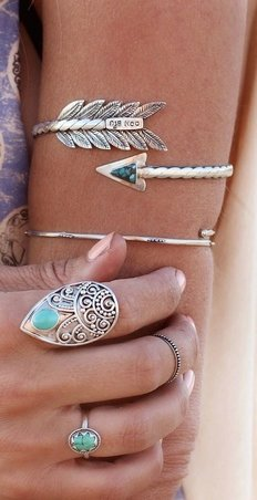 Wearing an Arrow Arm Bracelet with Tibetan Rings for a Modern Boho Look