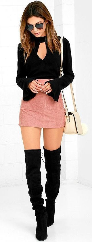 fashionable outfit / black top + pink skirt + bag + over the knee boots