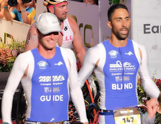 Blind IRONMAN triathlete Steve Walker and his guide, pro triathlete Chris Foster