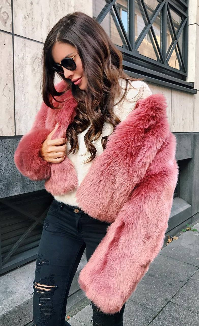 what to wear with a fur jacket : white sweater + black ripped jeans