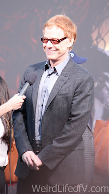 Composer Danny Elfman being interviewed on the red carpet