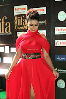 Apoorva in a Stunning Tight Leg Split Sleeveless Red Gown at IIFA Utsavam Awards 016.JPG