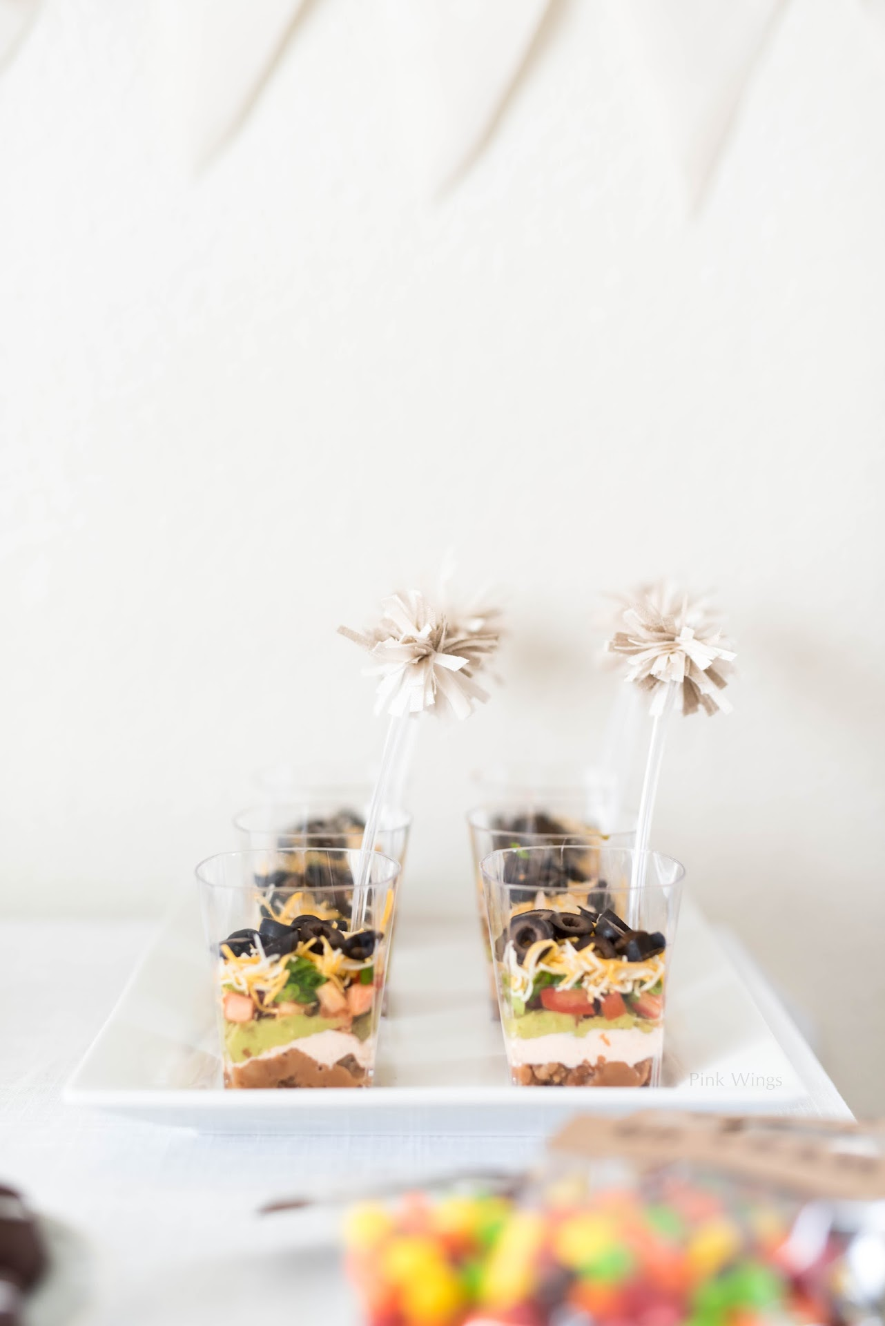 football party food ideas, tailgating, seven layer dip, diy cheerleader pom poms, football party decor, decorations,