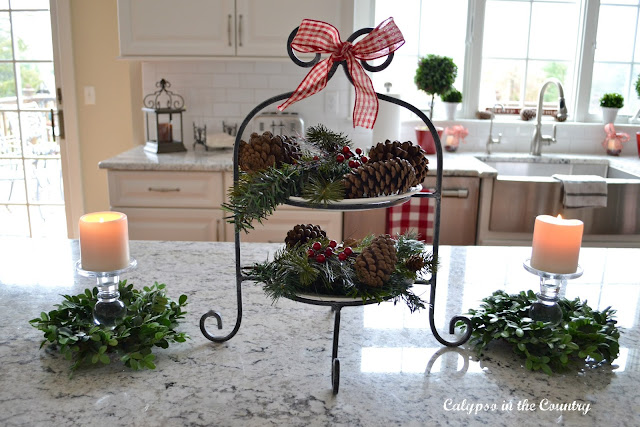 Christmas Vignette with tiered tray and pine cones