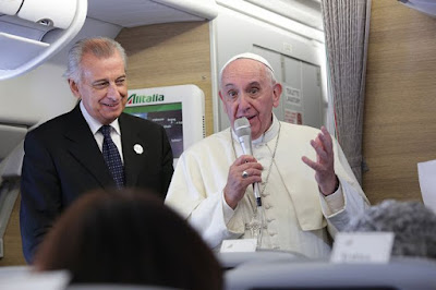 Pope standing up on plane