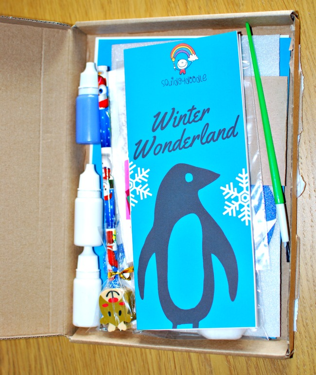 inside-the-squidgydoodle-subscription-box-showing-leaflet-pencil-small-bottles-and-paper