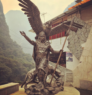 Inca statue in Aguas Calientes at the foot of Machu Picchu in Peru