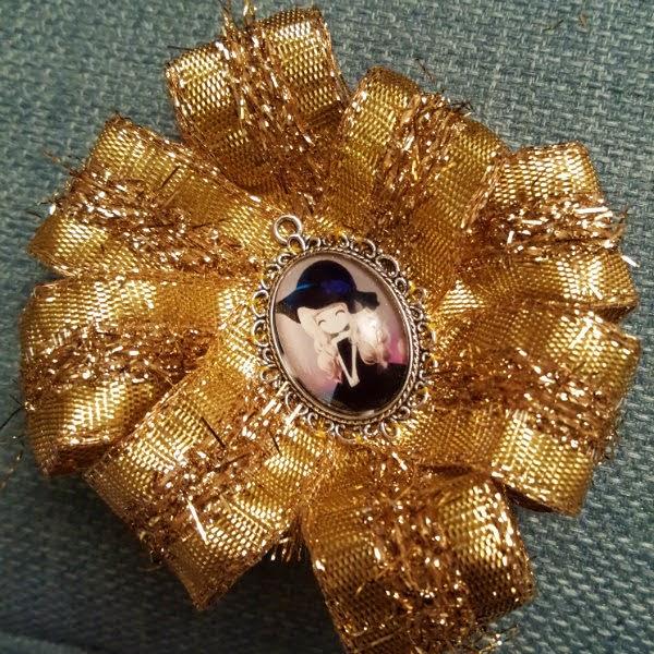 Framed kawaii cameo girl in centre of gold ribbon rosette