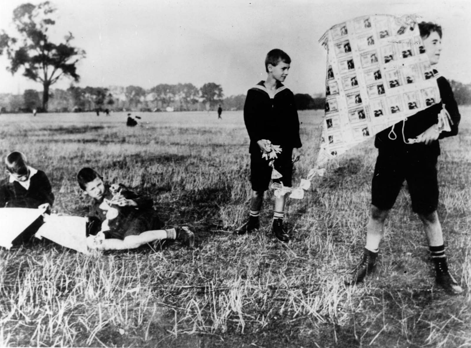 Boys fly a kite made of banknotes. 1922.
