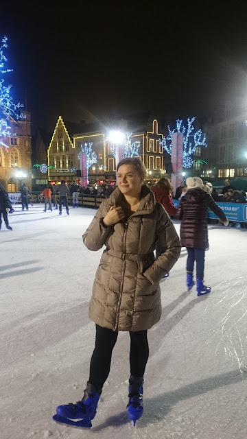Girl on ice, evening town