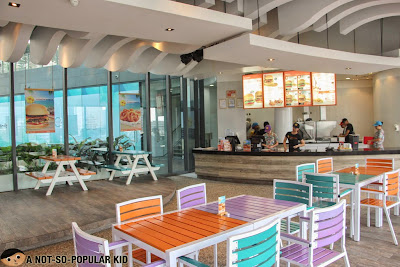 The cheerful, vibrant and energetic interior of Caliburger in Makati