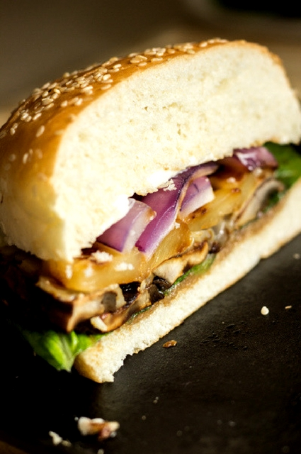 Grilled pineapple, mushrooms, red onion, cheese and lettuce on a bun