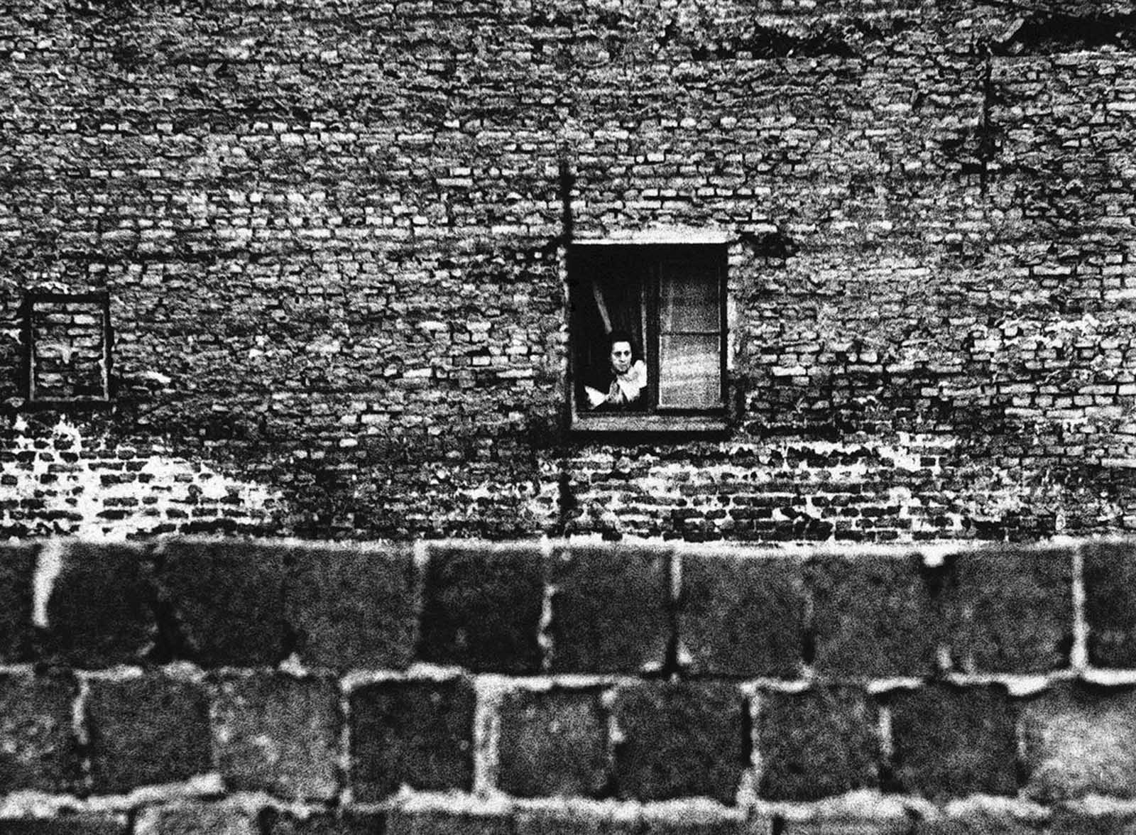 Typical of East Berlin measures to halt the escape of refugees to the west are these bricked-up windows in an apartment house along the city's dividing line October 6, 1961. The house, on the South side of Bernauerstrasse, is in East Berlin.