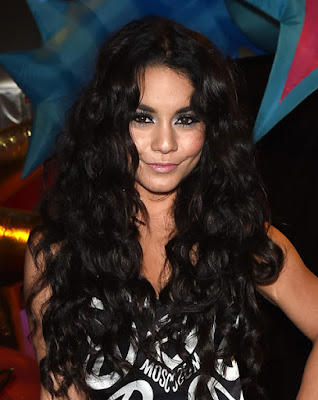 Vanessa Hudgens wears monochrome mini dress to the Moschino Fashion Show in LA
