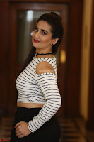 Manjusha in sleevelss crop top and black skirt at Darshakudu pre release ~  Exclusive Celebrities Galleries 004.JPG