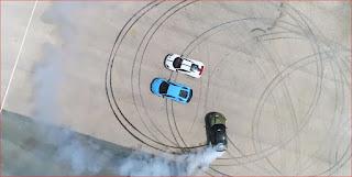 Drifting BMW M5 around Supercars