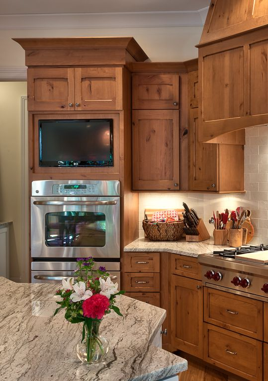 Knotty alder cabinets in a kitchen with granite counters.