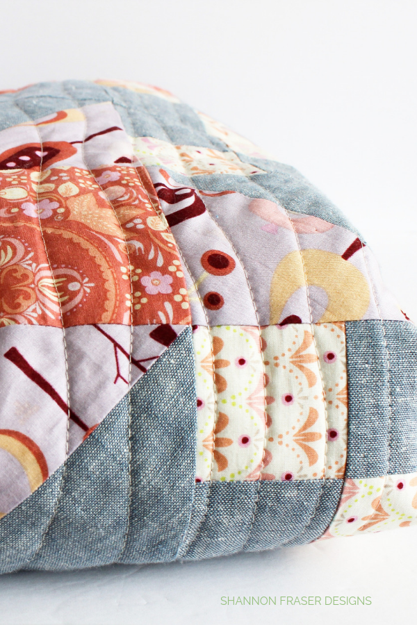 Close up of organic quilting on scrappy Irish Vortex Quilt | Shannon Fraser Designs