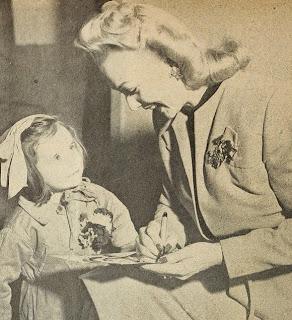 Carole Landis With A Child