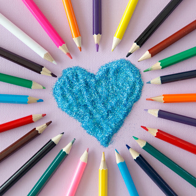 Glitter heart and coloured pencils