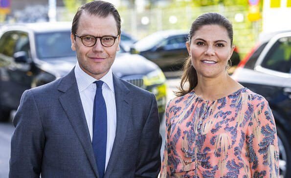 Crown Princess Victoria wore a printed floral silk dress from HM Conscious Exclusive collection, and Saint Laurent sandals. Quidam clutch