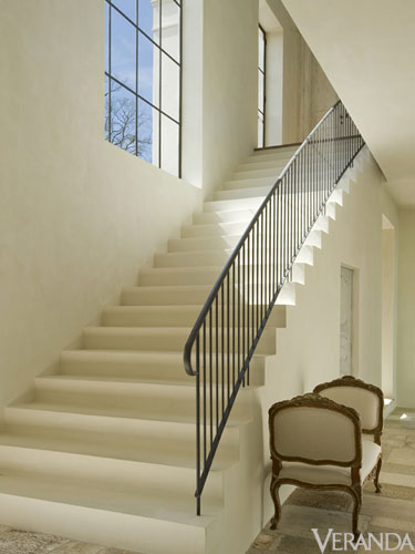 Pamela Pierce interior designed French country Houston home with plaster steps and French iron railing - architecture by Reagan Andre. #frenchcountry #interiordesign #staircase #frenchhome