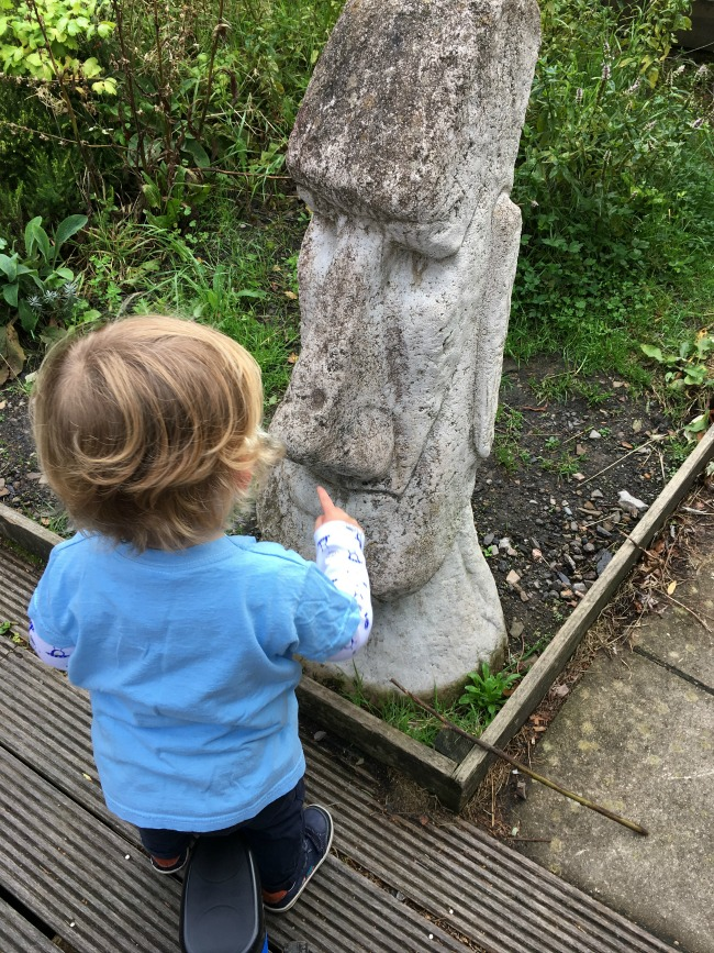 toddler-pointing-at-huge-Easter-Island-like-head-Cwm-Carn