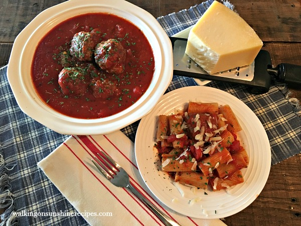 Enjoy your homemade slow cooker tomato sauce and meatballs over cooked pasta from Walking on Sunshine.