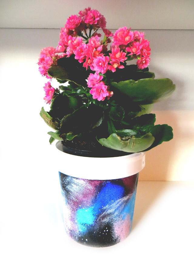 DIY galaxy home decor and desk organization. How to make a galaxy flower pot or pencil holder by recycling yogurt containers.