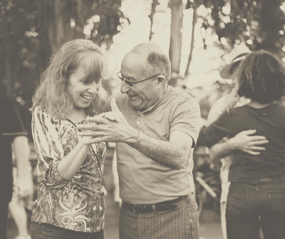 An old couple dances together as a way of spending time together.